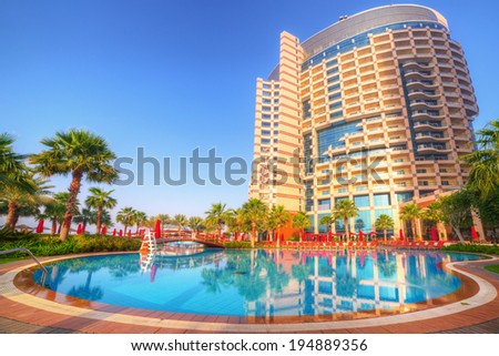 ABU DHABI, UAE - MARCH 30: Sunrise at the pool area of Khalidiya Palace by Rotana on March 30, 2014, UAE. Rotana Hotel Corporation has 85 properties in 26 cities around Middle East and Africa. - stock photo