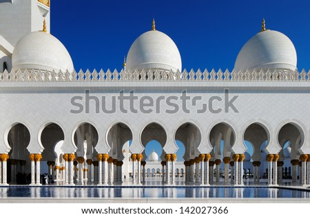 ABU DHABI, UAE - MAY 11: Sheikh Zayed Grand Mosque, Abu Dhabi, UAE on May 11, 2013 in Abu Dhabi. The 3rd largest mosque in the world, area is 22,412 square meters and the 4 minarets are 107 m high