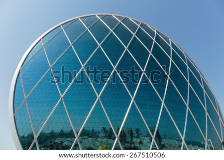 ABU DHABI, UAE - NOVEMBER 5: Aldar headquarters building is the first circular building of its kind in the Middle East on November 5, 2013 in Abu Dhabi, UAE