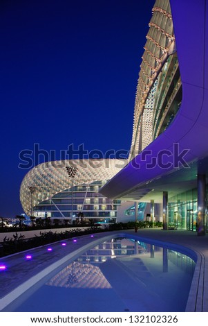ABU DHABI, UAE - OCT 17: The Yas Hotel - the iconic symbol of Abu Dhabi's Grand Prix on Oct 17, 2009 in Abu Dhabi, UAE. It is the first new hotel in the world to be built over an F1 race circuit - stock photo