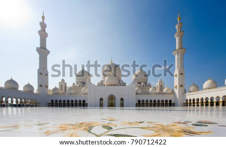 ABU DHABI, UNITED ARAB EMIRATES - DEC 28, 2017: The courtyard of the Sheikh Zayed Mosque in Abu Dhabi. It is the largest mosque in the country.