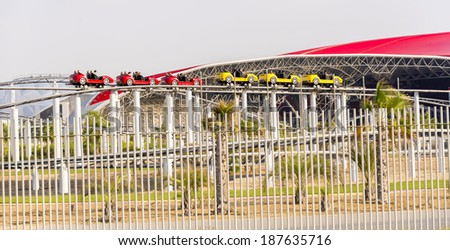 ABU DHABI, UNITED ARAB EMIRATES - DECEMBER 11: Ferrari World building details with roller coaster on December 11, 2013 in Abu Dhabi, United Arab Emirates.  - stock photo