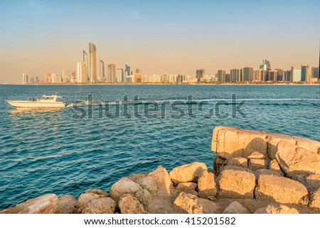 Abu Dhabi,United Arab Emirates- March 3,2016:Cityscape of Abu Dhabi with a boat passing by, UAE