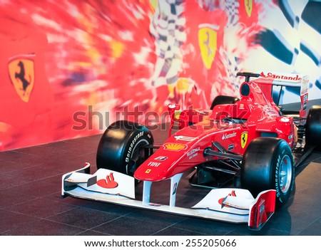 ABU DHABI, UNITED ARAB EMIRATES - March 28, 2013. Ferrari F1 race car on display at the Ferrari World amusement park at Yas Island, Abu Dhabi - stock photo