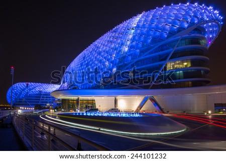 ABU DHABI, UNITED ARAB EMIRATES - MAY 23, 2013: The Yas Hotel - the iconic symbol of Abu Dhabi's Grand Prix in Abu Dhabi, UAE. - stock photo