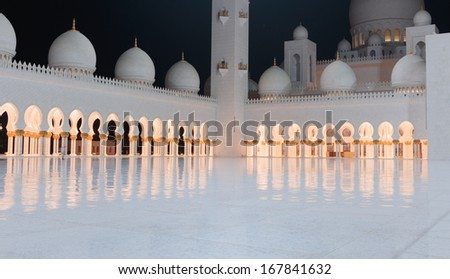 ABU DHABI, UNITED ARAB EMIRATES - NOVEMBER 5: Sheikh Zayed Grand Mosque evening view on November 5, 2013 in Abu Dhabi, United Arab Emirates. The famous Sheikh Zayed mosque is the largest mosque in UAE