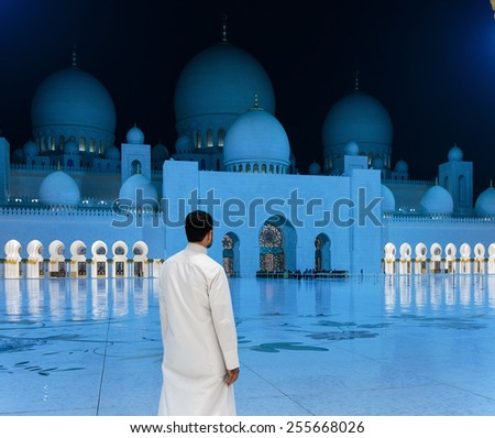ABU DHABI, UNITED ARAB EMIRATES - NOVEMBER 5: Sheikh Zayed Grand Mosque evening view on November 5, 2013 in Abu Dhabi, United Arab Emirates. The famous Sheikh Zayed mosque is the largest mosque in UAE - stock photo
