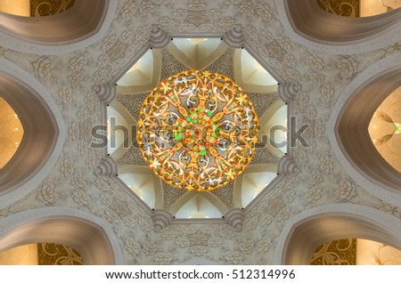 Abu Dhabi, United Arab Emirates - October 5, 2016: a chandelier hanging under a dome in the main prayer hall of the Sheikh Zayed Grand Mosque. The main prayer hall can hold 7000 worshippers.