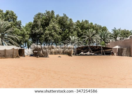 ABU DHABI, UNITED ARAB EMIRATES - SEPTEMBER 5, 2015: View of Heritage Village - one of the best cultural attractions. It is a re-creation of an Emirates village and showcases the Bedouin lifestyle. - stock photo