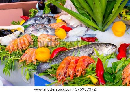 Abundance of seafood on the ice - stock photo