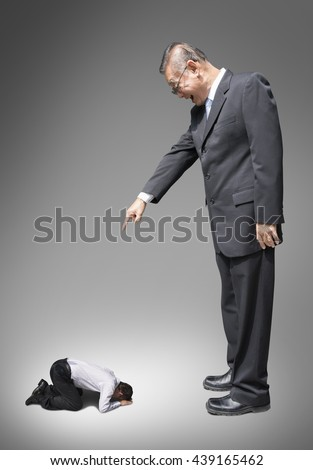 abuse and bully business man on abstract dark background , boss and subordinate , asian people business - stock photo