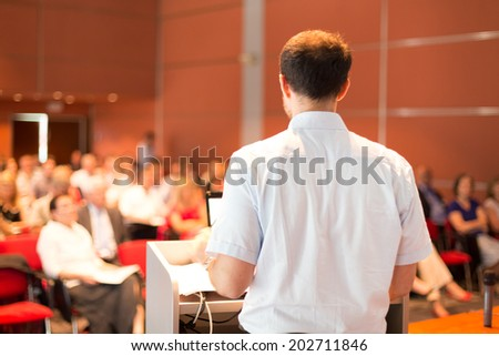 Academic professor lecturing at Conference. Audience at the lecture hall. - stock photo