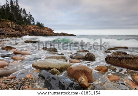 Acadia National Park, otter cliff area with an incoming wave curl - stock photo