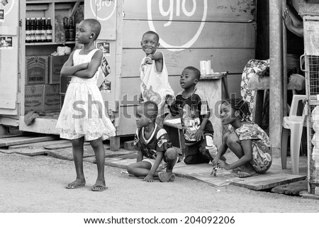ACCARA, GHANA - MAR 2, 2012: Unidentified Ghanaian children in the street in black and white. People of Ghana suffer of poverty due to the unstable economical situation