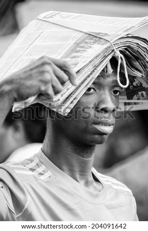 ACCARA, GHANA - MAR 4, 2012: Unidentified Ghanaian man covered with newpapers in black and white. People of Ghana suffer of poverty due to the unstable economical situation