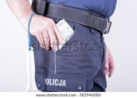 accepting bribes by corrupt Polish policeman - stock photo