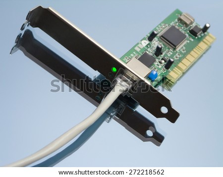Access online concept with ethernet network interface, attached cable and green lit led light on reflective surface - stock photo