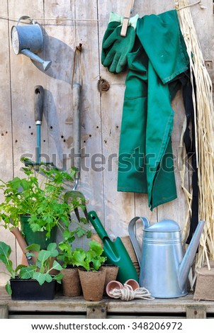 accessories and gardening tool  hanging on wooden floor - stock photo