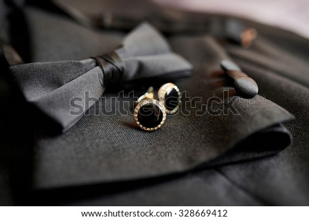 Accessories butterfly and cufflinks for a classic suit. - stock photo
