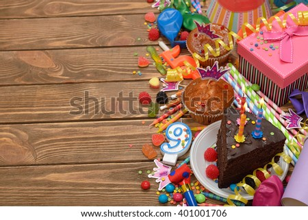 Accessories for children's parties on a brown background - stock photo