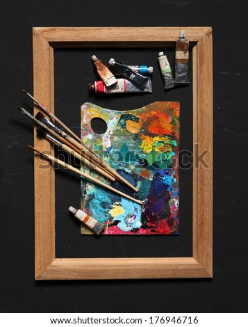 Accessories for painting / studio photography of paint utensils on black background  - stock photo
