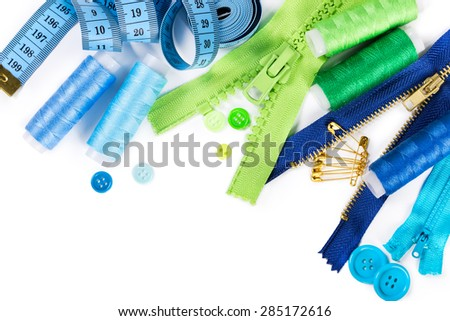 Accessories for sewing - zipper, thread, buttons and measuring tape isolated on white background - stock photo