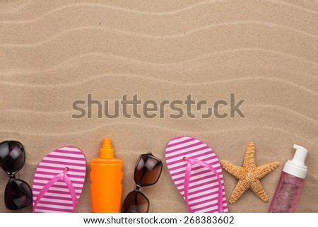Accessories for the beach  lying on the sand, with place for your text - stock photo