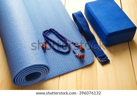 Accessories for yoga.Mat, mala beads, foam block and strap. - stock photo