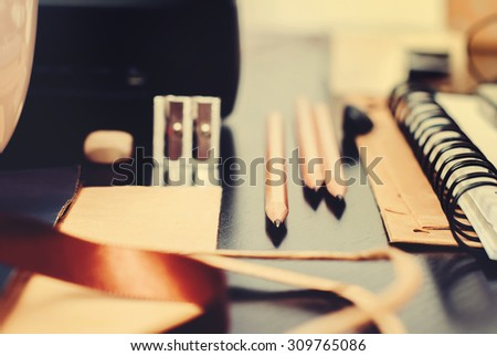 Accessories on Black Office Wooden Table, selective focus, toned - stock photo