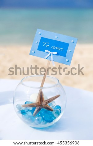 Accessory kit for a wedding is on the shores of the Caribbean Sea.