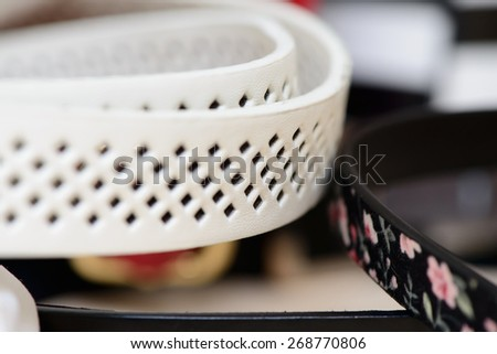 accessory two leather belts for trousers closeup - stock photo