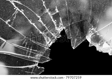 Accident cracked damaged broken house window glass - stock photo
