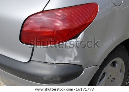 Accident damage to the rear of a car - stock photo