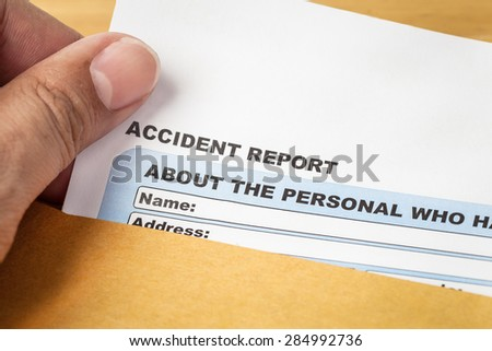 Accident report application form and human hand on brown envelope, business insurance and risk concept; document is mock-up