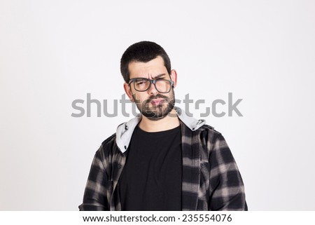 Accidented guy wearing black glasses - stock photo