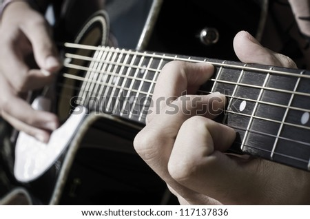 according performed on an acoustic guitar - stock photo