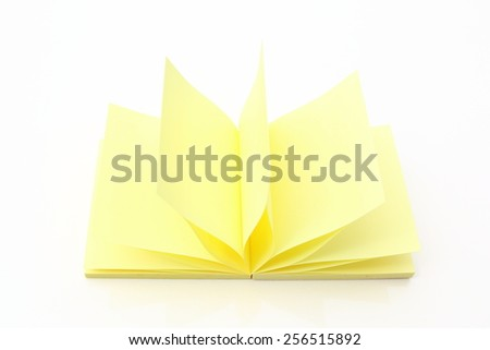 accordion Block of yellow Post it Notes isolated on white. - stock photo
