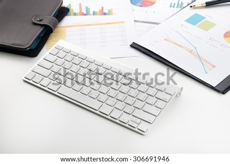 account document and keyboard on office desk