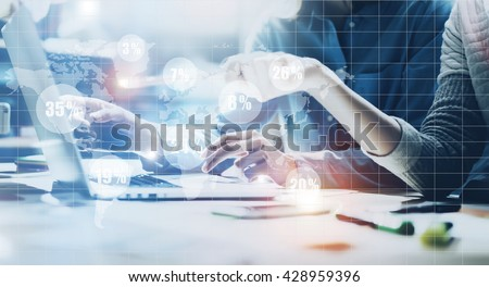 Account team meeting.Photo young business crew working new startup project.Notebook wood table.Idea presentation,analyze marketing plans.Digital Connections World Wide Interfaces Screen.Film effect - stock photo