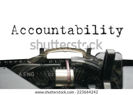 Accountability on typewriter - stock photo