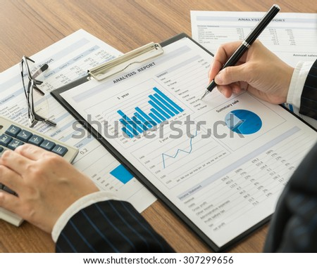 accountant are analyzing the data from the report. working at office  - stock photo