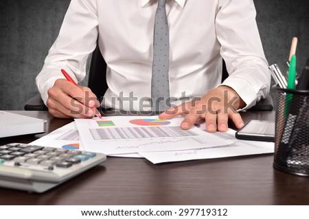 accountant checks the annual report - stock photo