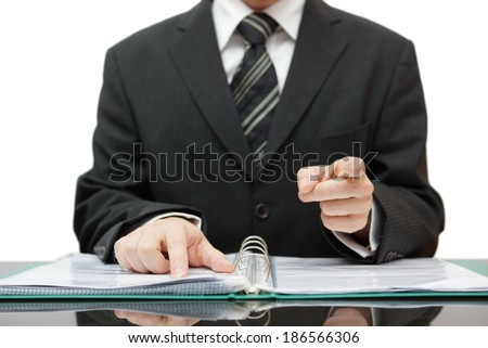 accountant or auditor pointing to you, gives a warning - stock photo