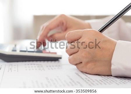 Accountant review the numbers in the financial statements.  Accounting Concepts. - stock photo