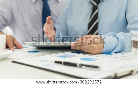 Accountants are analyzing data from the financial statements of the Company. - stock photo
