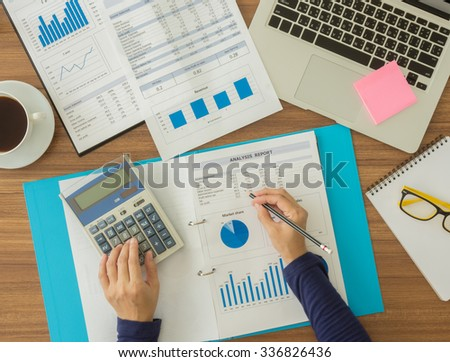 Accountants are working to analyze company data. top view. accounts concept. - stock photo