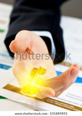 Accounting. businessman holding the key to success. - stock photo
