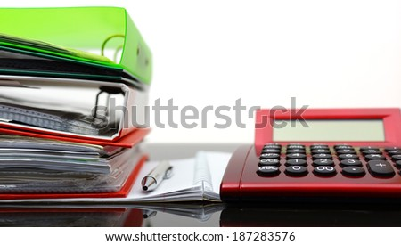 accounting concept with binders, folders,notebook, pen and calculator - stock photo