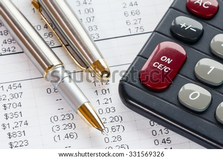 Accounting in process with calculator,pen  and financial document - stock photo