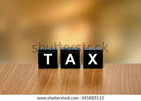 accounting tax on black block with blurred background - stock photo